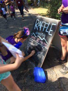 Volunteer Creating Prize Raffle Schedule